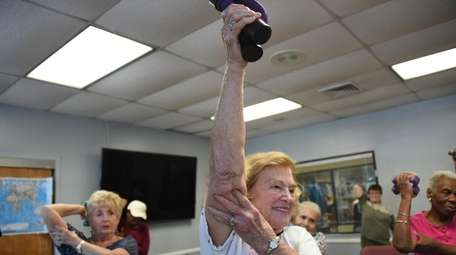Leona Gordnick, 91, of Northport, exercises with weights