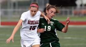 MacArthur's Tara Sweeney (15) battles for the ball