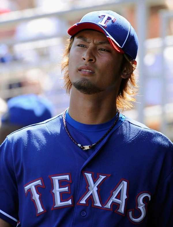 Yu Darvish walks through the dugout after pitching