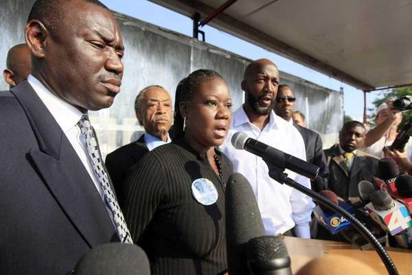 Family attorney Benjamin Crump, left, and The Rev.