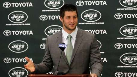 Tim Tebow addresses the media as he is
