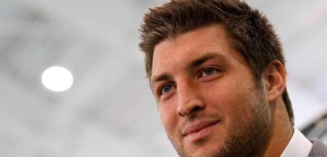 Quarterback Tim Tebow addresses the media as he