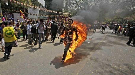 A Tibetan exile man, identified as Jampa Yeshi,