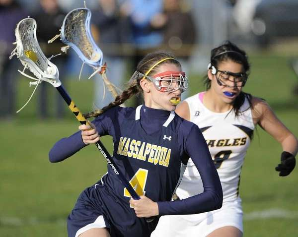 Massapequa midfielder Kristin Yevoli controls the ball against