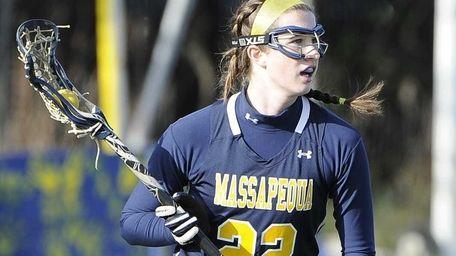 Massapequa attacker Kelsey O'Brien looks to pass against