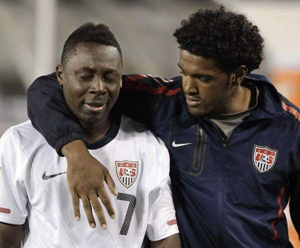United States' Freddy Adu (7) is consoled as