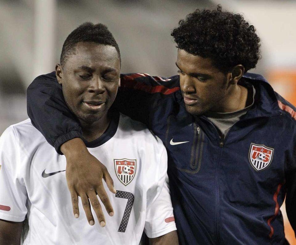 United States' Freddy Adu (7) is consoled as