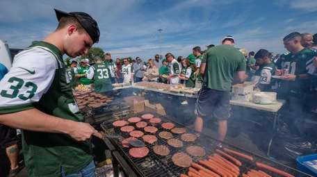 Jake Pohevitz mans the grill during the Mulcahys