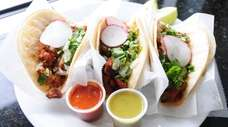 A trio of carnitas tacos at El Paso