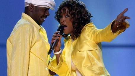 Whitney Houston, right, and her husband, Bobby Brown,