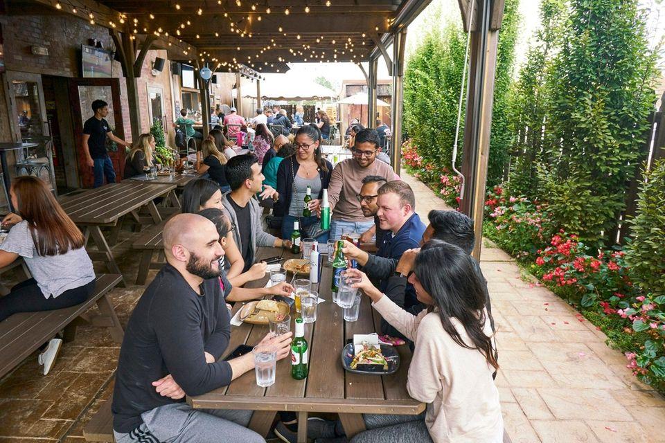 Patrons toast Oktoberfest season at Garden Social in