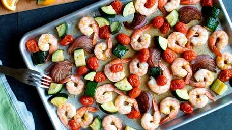 Shrimp, zucchini, onion and tomatoes roasted on a
