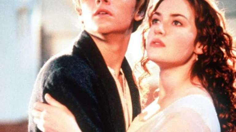 Leonardo DiCaprio, in character as Jack, holds Kate