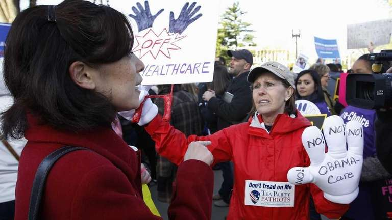 Christine Harley, from Alexandria, Va., left, argues with