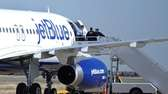Authorities board JetBlue Flight 191, which was headed
