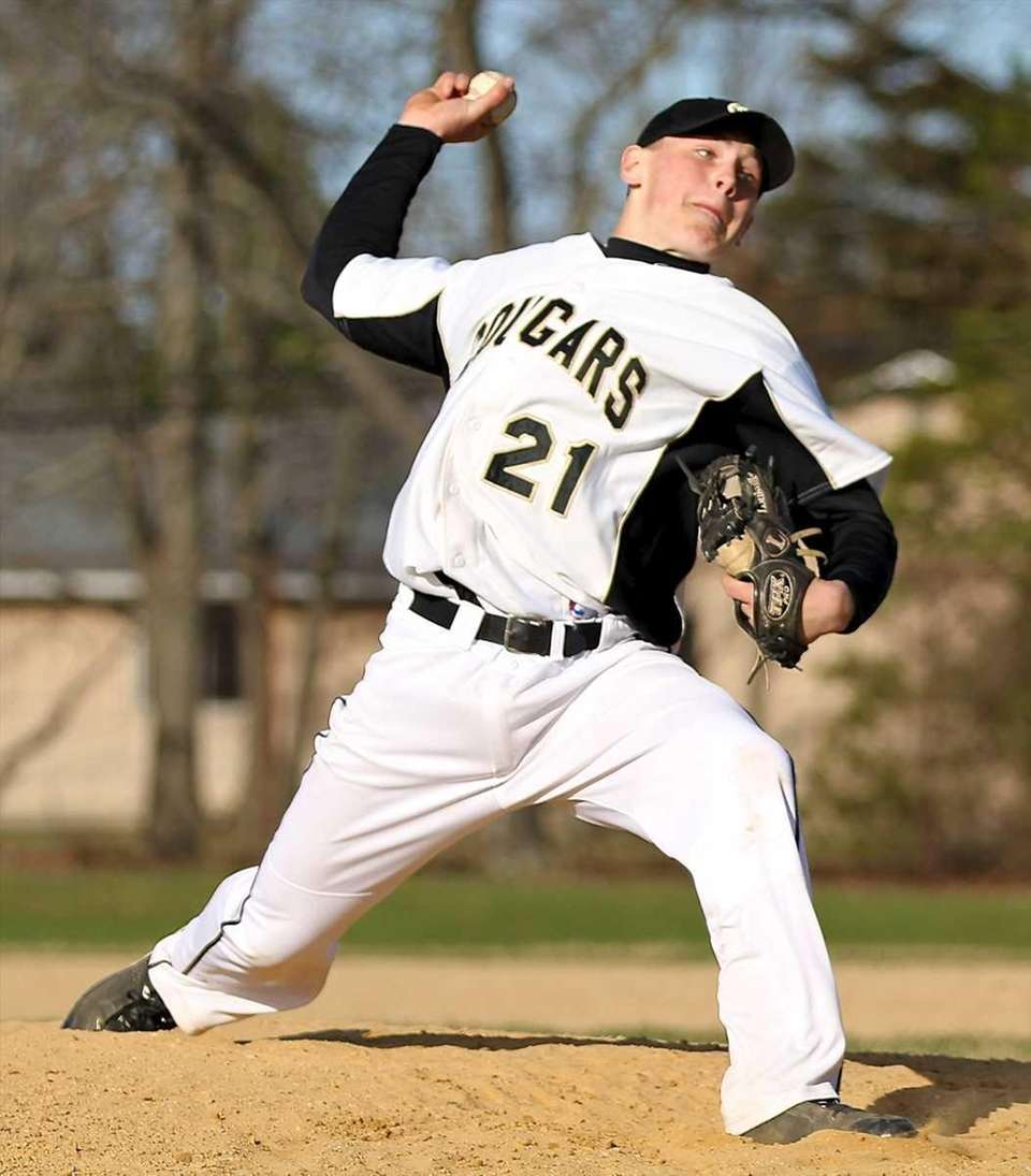 Commack starting pitcher Ryan Heizman delivers to the