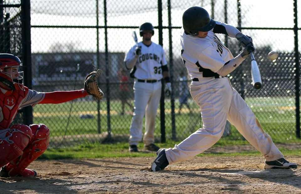 Commack's Nicholas Perullo connects for a hit against