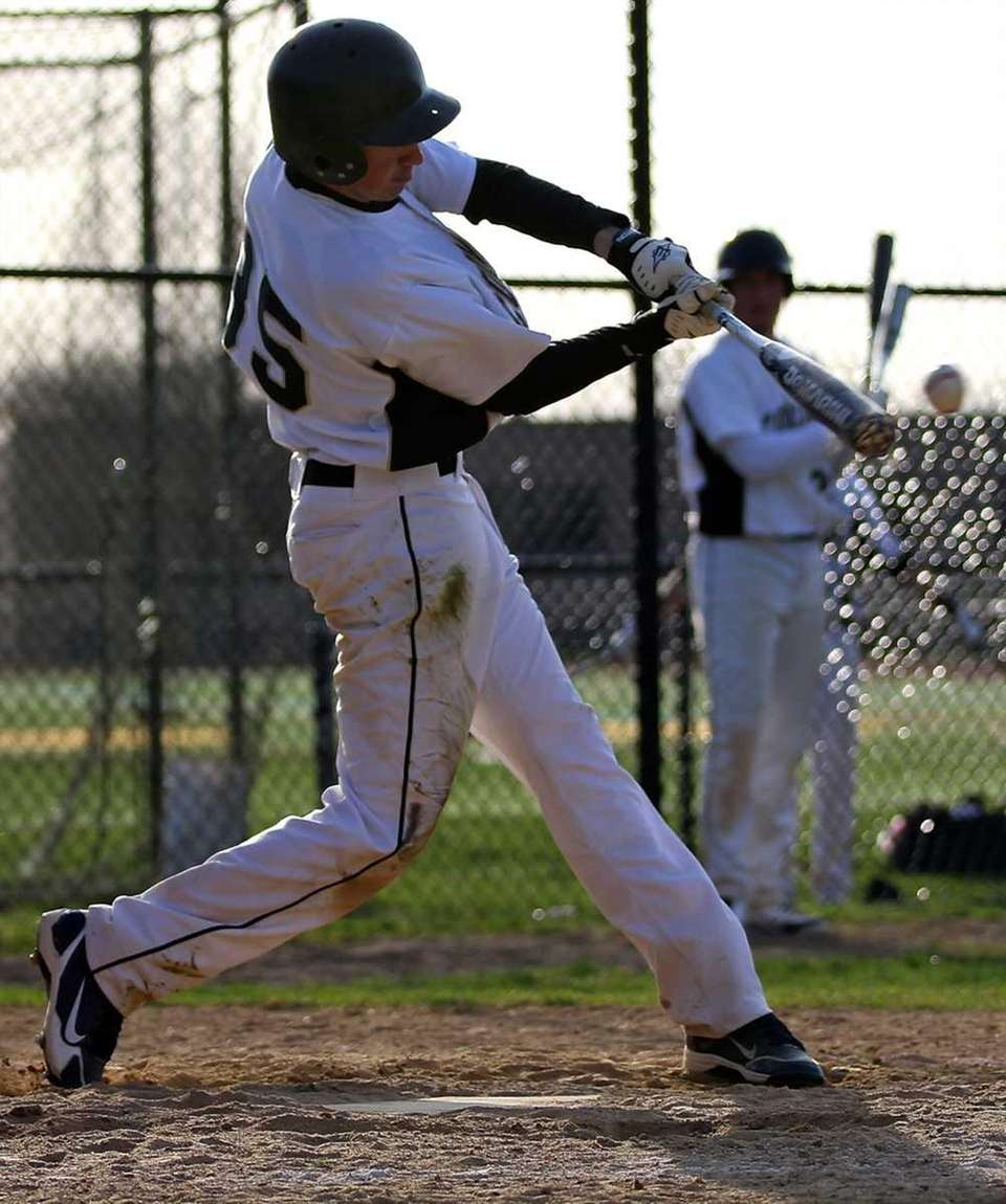Commack's Matthew Guaglione connects for a hit. (March