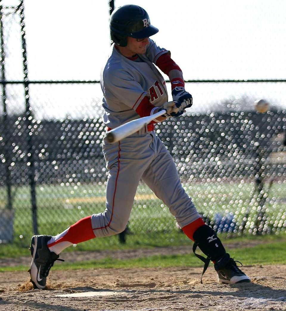 Patchogue-Medford's Matt Vogel connects for a hit against