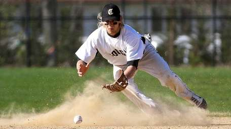 Commack shortstop Keith Andrews looks to grab the
