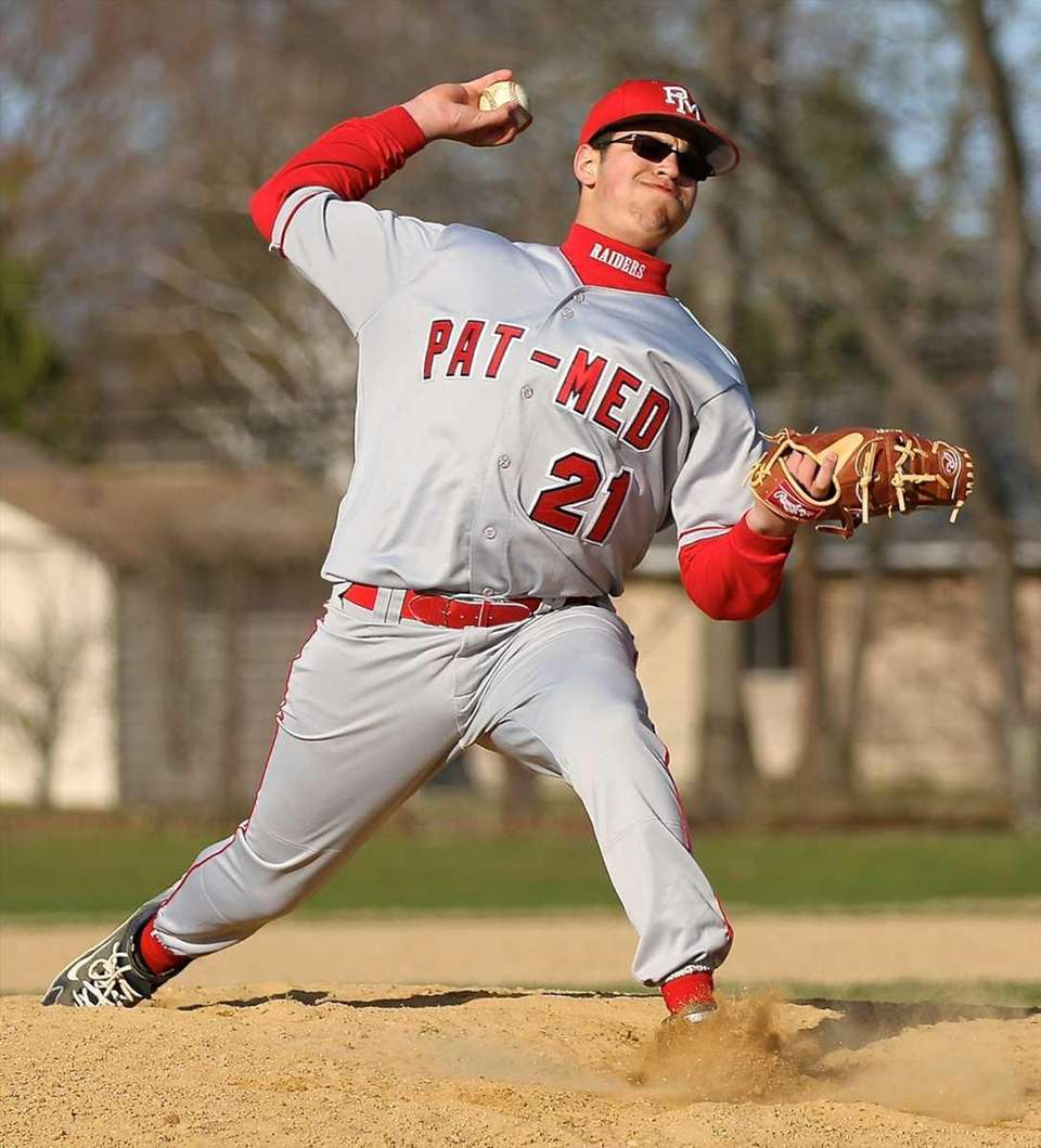 Patchogue-Medford relief pitcher Andrew Garcia throws. (March 27,