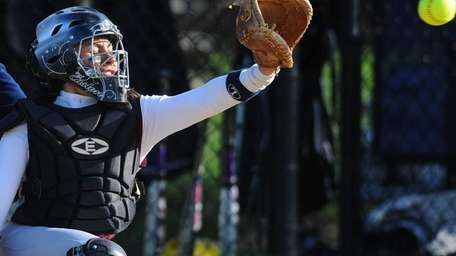 Clarke catcher Selena Ruiz frames a pitch for