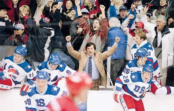 Olympic Hockey coach Herb Brooks (KURT RUSSELL, center)
