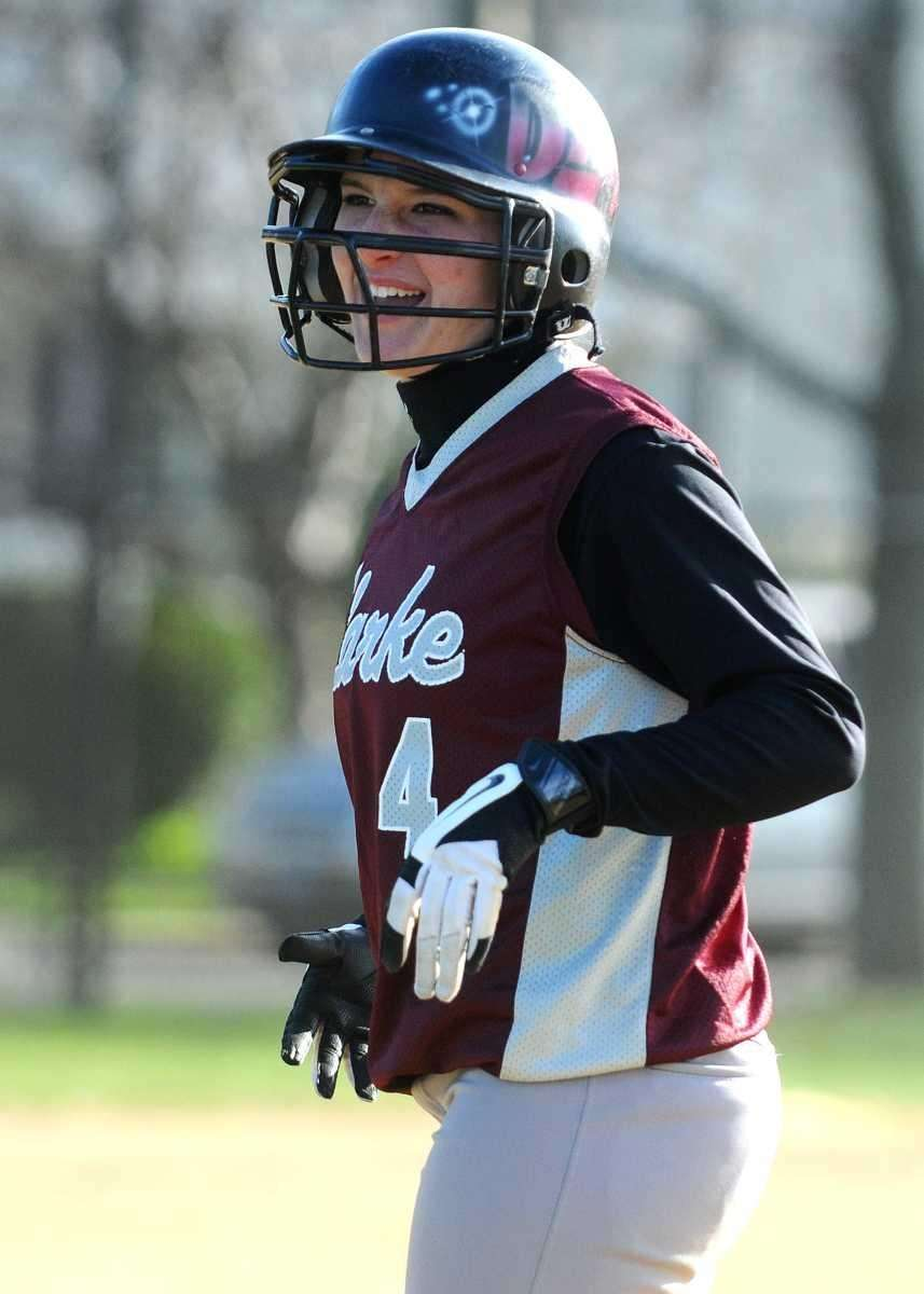Clarke center fielder Demi Shanahan reacts after hitting