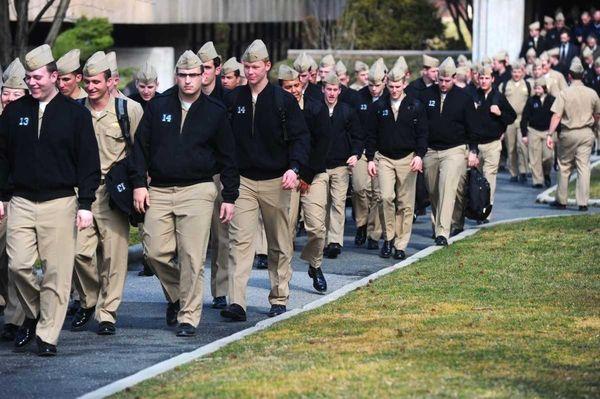 U.S. Merchant Marine Academy midshipmen walk out of