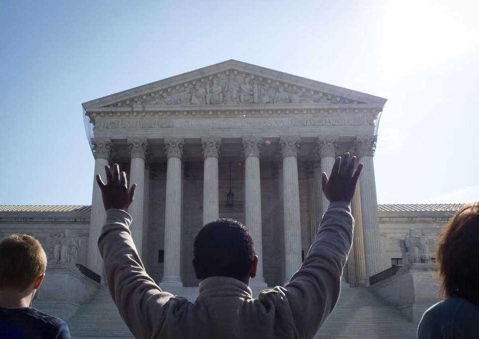 Protesters pray outside the U.S. Supreme Court on