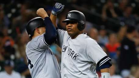 Yankees' Edwin Encarnacion, right, celebrates his two-run home