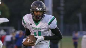 Wyandanch's Deandre Smith #4 carries the ball during