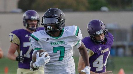 Wyandanch's Rashaun Malloy #7 out runs Greenport's Jack