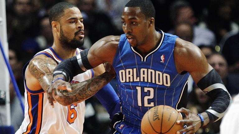 The Orlando Magic's Dwight Howard (12) is defended
