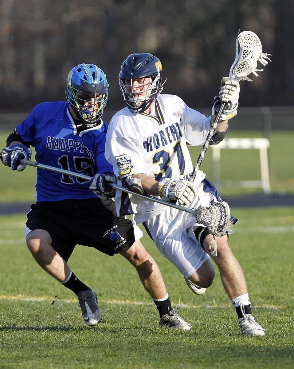 SWR's Trevor Brosco (31) drives against Hauppauge's Corey