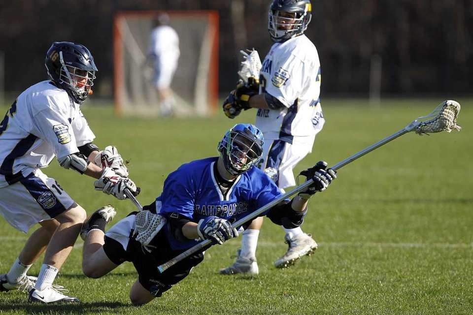 Hauppauge's Corey Zellin (15) is forced to the