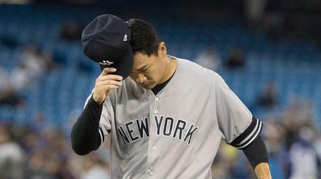 Yankees starting pitcher Masahiro Tanaka comes off the