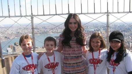 Actress Lily Collins, who stars as Snow White