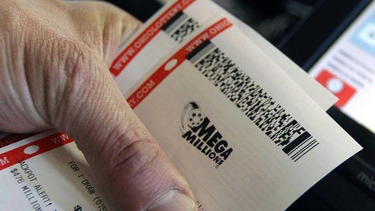 Johnny Maroun sells Mega Million lottery tickets to