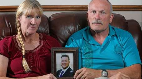 Rod and Tonya Meldrum hold a portrait of