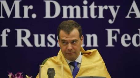 Russian President Dmitry Medvedev looks on after being
