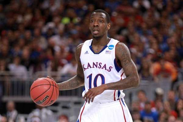 Tyshawn Taylor of the Kansas Jayhawks brings the