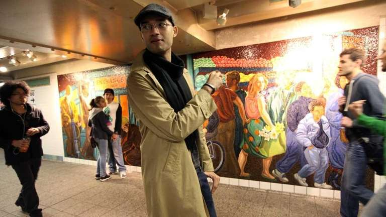 Ruddy Harootian in front of a mosaic by