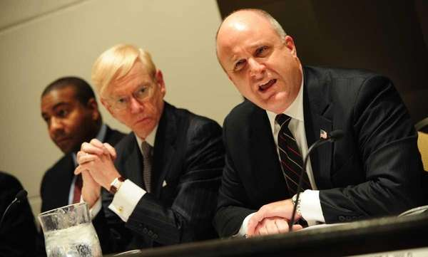 Christopher Wright, right, addresses a meeting of the