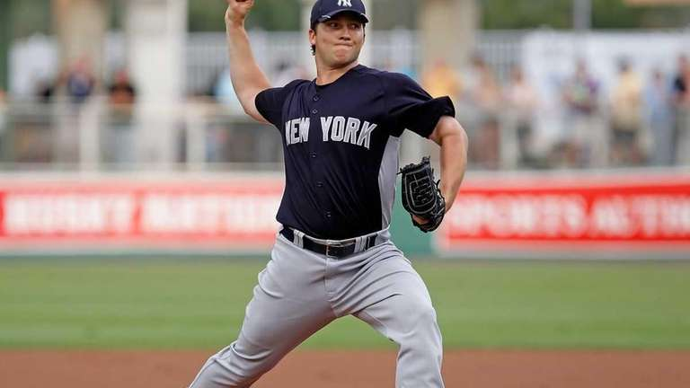 Adam Warren of the Yankees pitches against the