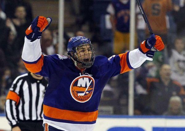 Travis Hamonic celebrates the Islanders' final goal against
