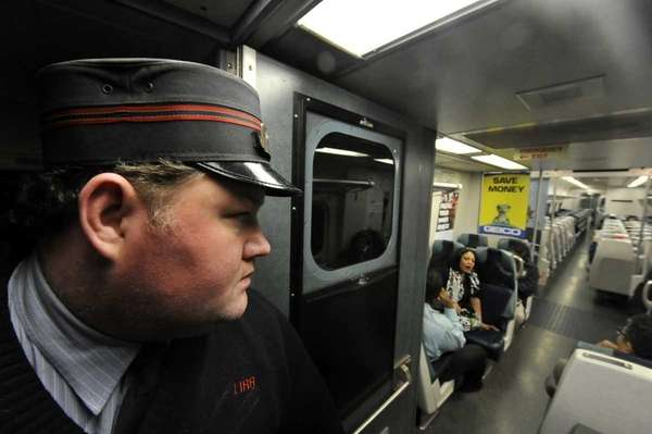 LIRR Conductor Tim Denehy annouces to passengers in