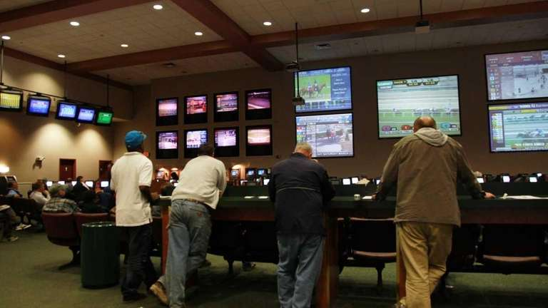 Patrons stand in Suffolk OTB in Hauppauge (March