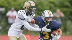 Massapequa's Alex Rende (3) catches a pass and