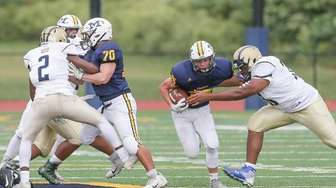 Massapequa's Timothy Morrow (35) breaks through the line